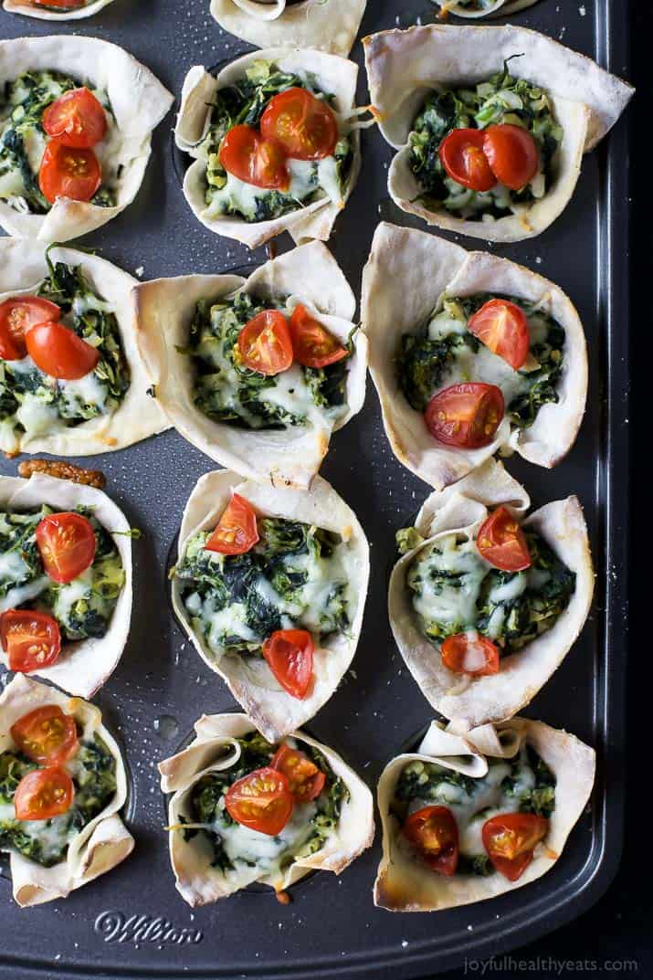 Easy Baked Wonton Bites filled with homemade Spinach Artichoke Dip - a delicious healthy appetizer perfect for entertaining a large crowd.