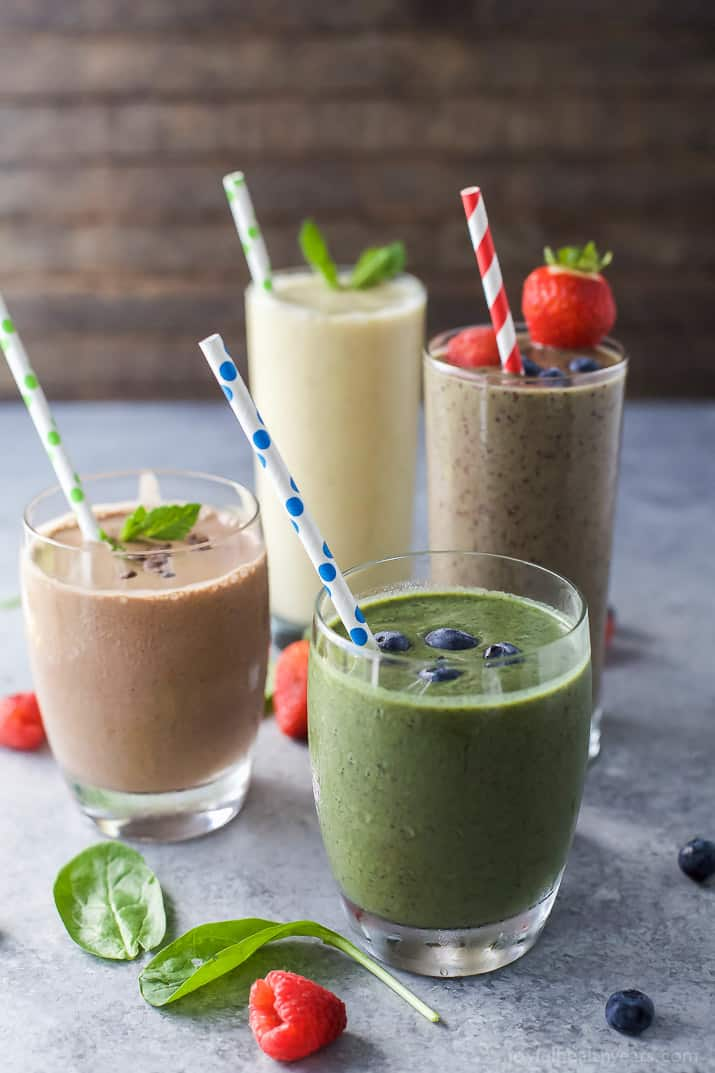 4 glasses of smoothies with straws