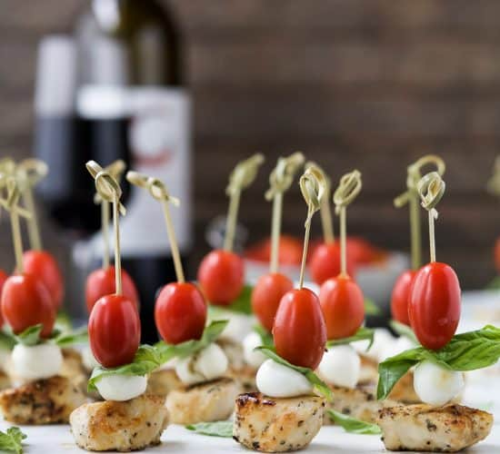 Easy Caprese Chicken Skewers drizzled with a homemade Balsamic Glaze absolutely irresistible and make theULTIMATE party appetizer! Just watch these gluten free caprese bites disappear from the appetizer table! #ad