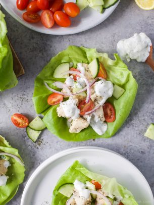greek chicken lettuce wraps with tomato, onion and homemade tzatziki on top