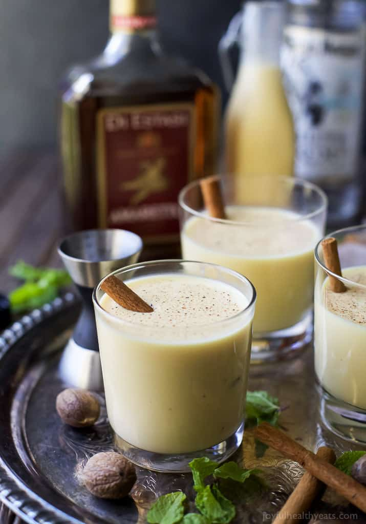 Dairy Free Holiday Spiked Eggnog with Amaretto and White Rum - a delicious creamy cocktail for the holidays. This Spiked Eggnog is a boozy treat perfect for a crowd!