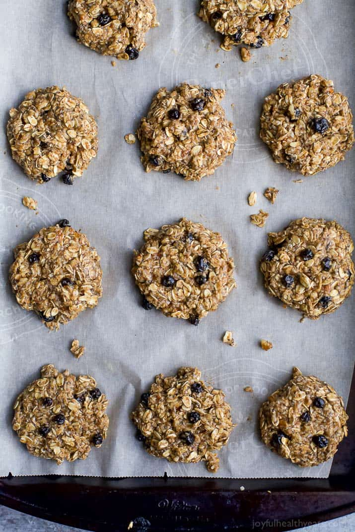 Top view of Blueberry Breakfast Cookies on a parchment-lined baking sheet