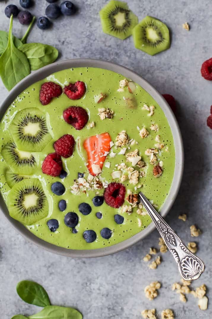 Top view of a Green Smoothie Bowl with fresh fruit and nuts