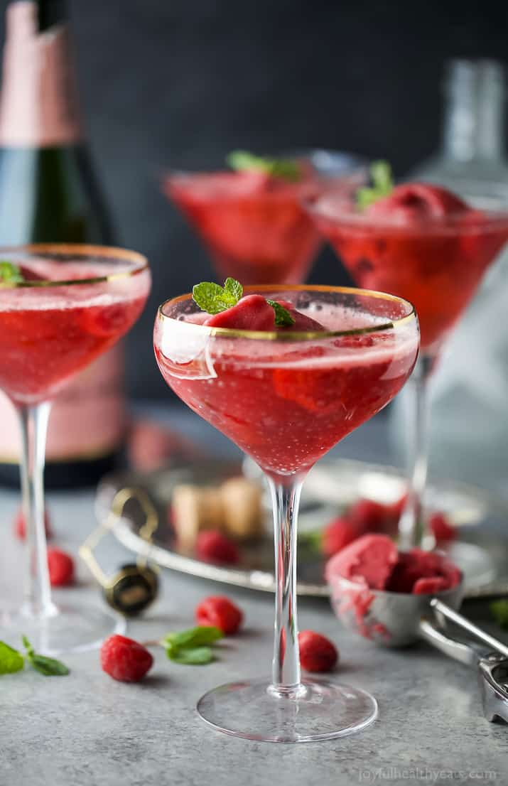 Raspberry Sorbet Rosé Floats - an fun beautiful cocktail to serve on Valentines Day or a ladies brunch! Made with raspberry sorbet, Rosé and vanilla vodka!