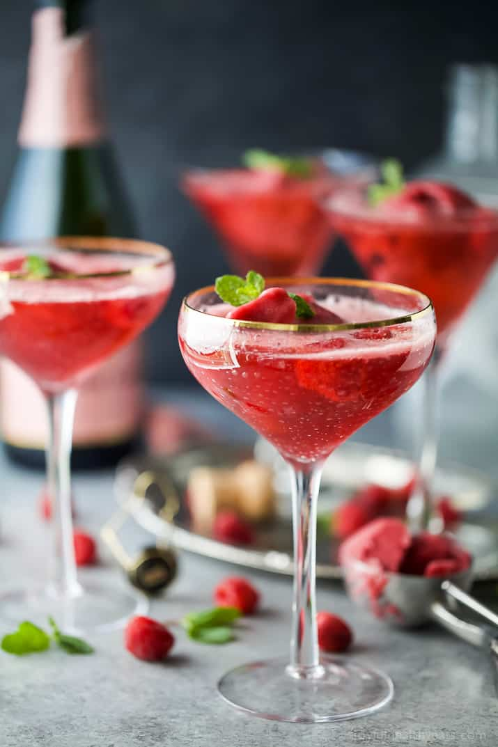 raspberry sorbet rose float in a wine glass