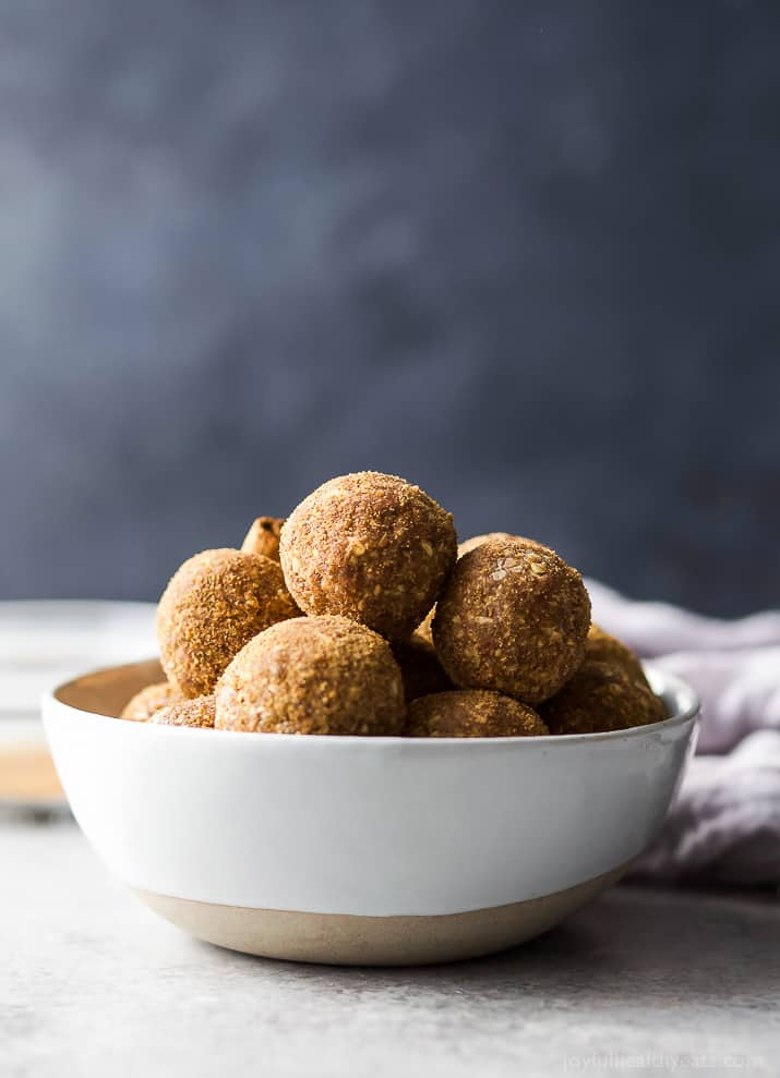 These easy Snickerdoodle Energy Balls are made in a blender and then rolled in a cinnamon coconut sugar crust. They taste just like snickerdoodle cookies and are the perfect breakfast, post workout snack or late night treat. #ad