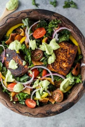 BLT Salmon Salad with Creamy Avocado Dressing in a wooden bowl
