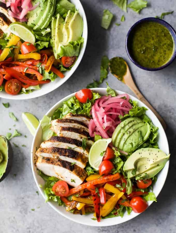 30 Minute Chicken Fajita Salad with fresh veggies, chipotle chicken, creamy avocado then topped with a zesty Chimichurri Dressing. This Chicken Fajita Salad is one flavorful dinner recipe that's sure to please any crowd.