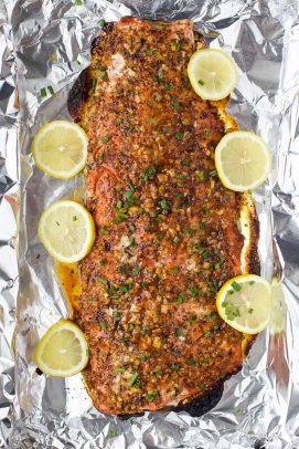 easy honey mustard baked salmon on a baking sheet after coming out of the oven