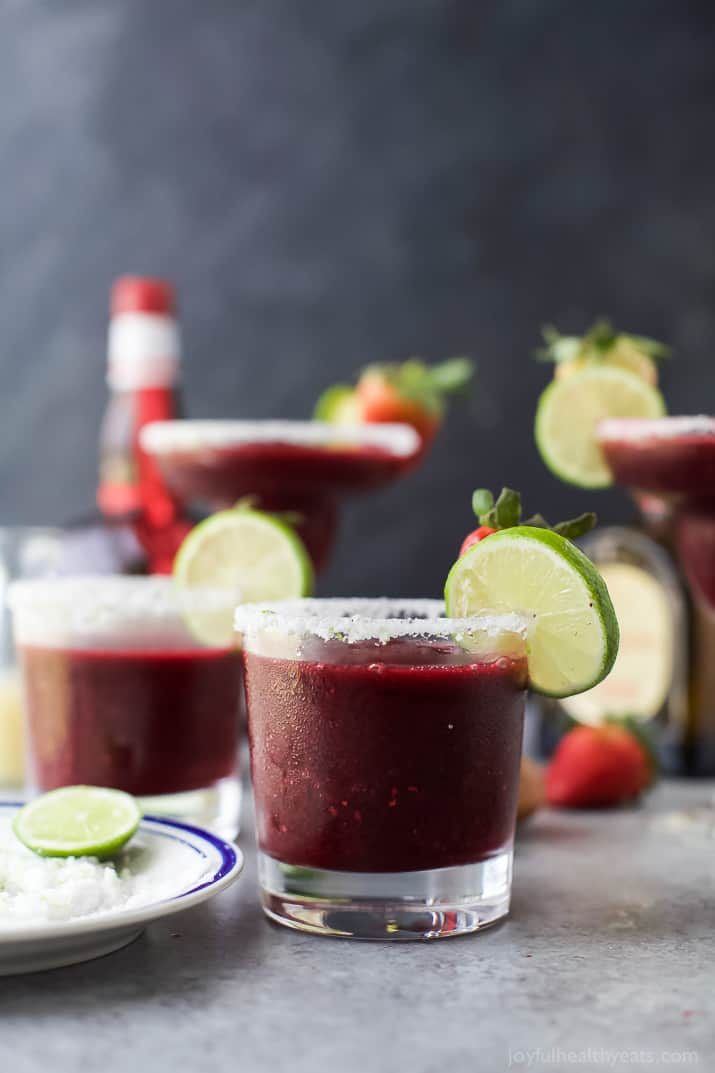 Fresh Berry Frozen Margaritas in a pitcher - loaded with sweet berries, agave, tequila, and fresh juices. It's the perfect party cocktail! These frozen margaritas are delicious, extremely smooth and fruity - guaranteed to be a crowd pleaser!