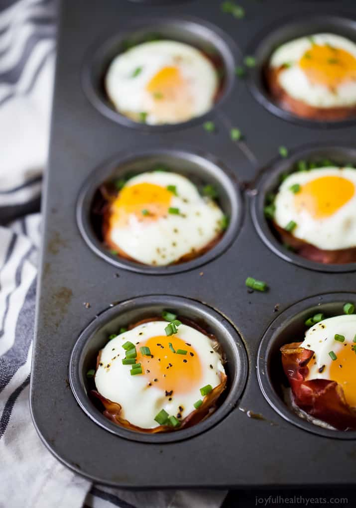 close up of PROSCIUTTO BAKED EGG CUPS in a muffin tin