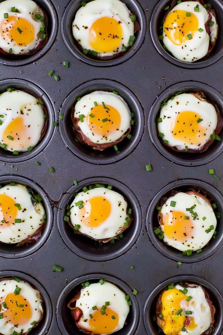 PROSCIUTTO BAKED EGG CUPS in a muffin tin