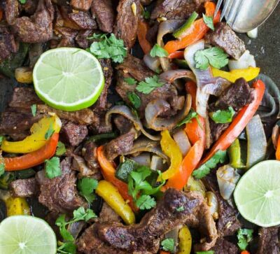 Easy 30 Minute Sheet Pan Steak Fajitas topped with zesty chimichurri - everything is made on one pan for easy cleanup. These Steak Fajitas make a healthy delicious dinner that your family will love!