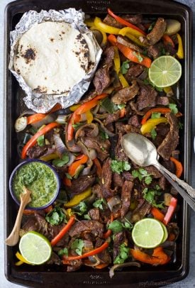 easy sheet pan steak fajitas served on a baking sheet