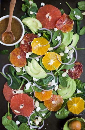 Winter Fruit Avocado Salad made with fresh citrus, avocado, spinach and goat cheese. This gorgeous citrus salad is done in 15 minutes and makes the perfect side for any meal!