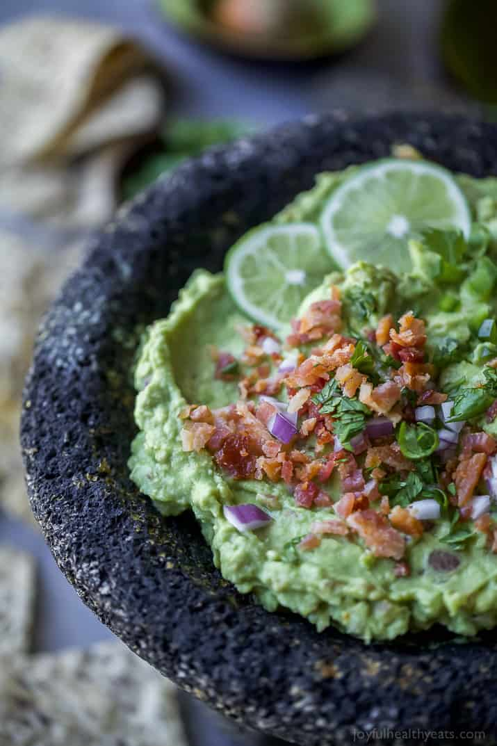 Creamy Bacon Guacamole - you'll love this twist on a classic. Crispy bacon pieces are the perfect addition to take this 5 minute guacamole over the top! It's a must have appetizer for your next party! {paleo, gluten free & keto friendly}