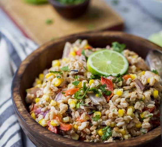 A delicious Farro Salad filled with Char Grilled Corn, Roasted Red Pepper and creamy goat cheese. Yup... it's incredible! It's the perfect side dish to bring to your next party or mid-week lunch.