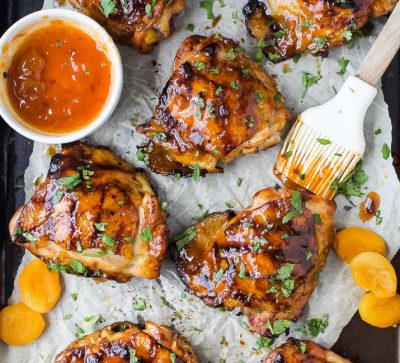 Sweet & Spicy CHIPOTLE APRICOT GRILLED CHICKEN THIGHS - juicy smoky chicken thighs slathered in an easy chipotle apricot glaze that will make you swoon! You'll be making this easy chicken recipe on repeat this summer.