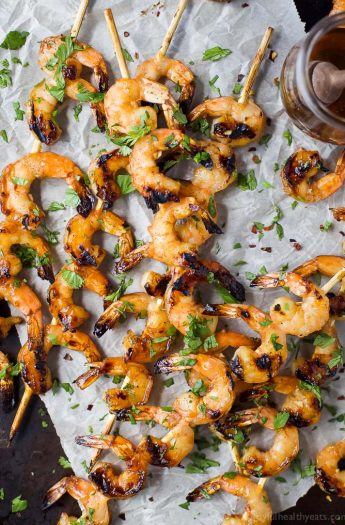 Easy 30 Minute Honey Garlic Grilled Shrimp withonly 4 ingredientsand full of bold flavors. These grilled shrimp will be a favorite this summer - I guarantee you'll be licking your fingers!