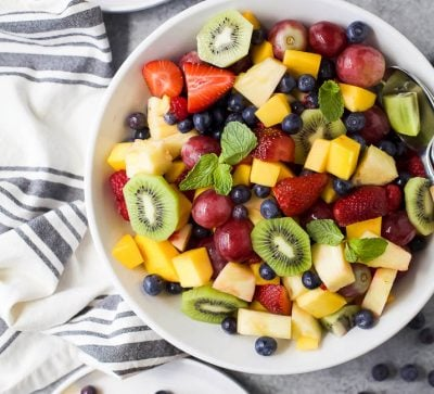 The BEST Summer Fruit Salad filled with loads of fresh fruit and dressing FREE. It's the perfect refreshing salad to have around all summer long that's naturally gluten free.