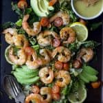 A quick 15 minute Grilled Shrimp Caesar Salad with a homemade egg and anchovy free caesar dressing! This Grilled Salad is light, refreshing and perfect for the summer!