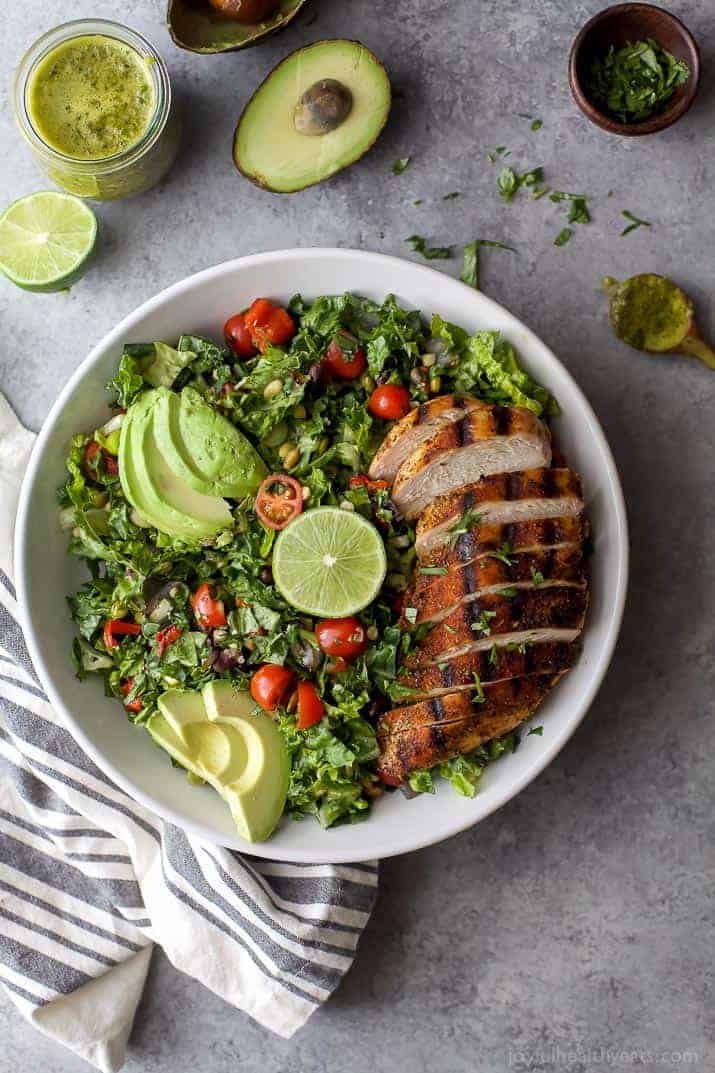 A fresh Chopped Salad with grilled chicken and avocados in a large white bowl
