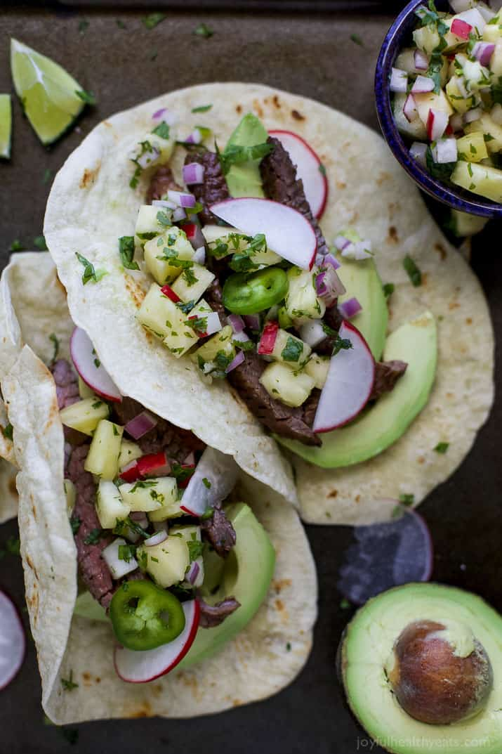 The BEST Steak Tacos ever made with a surprise ingredient for a sweet salty marinade you'll adore. Top these tender Steak Tacos with a Radish Pineapple Salsa for one delicious finish! Guaranteed to be your favorite!