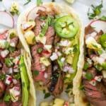 close up of marinated steak tacos