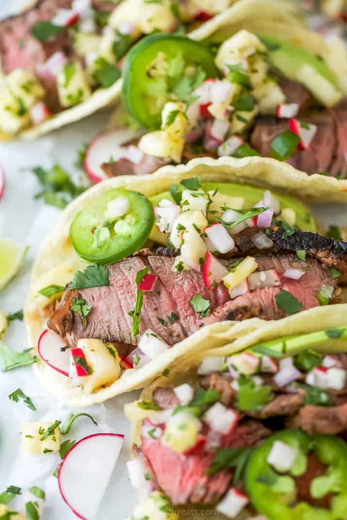 side photo of grilled steak tacos with pineapple salsa