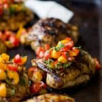 Balsamic Grilled Chicken Thighs topped with a fresh tomato Bruschetta. An easy 30 minute meal that will quickly become the ultimate grilling recipe you'll want all summer! #ad #glutenfree #paleo