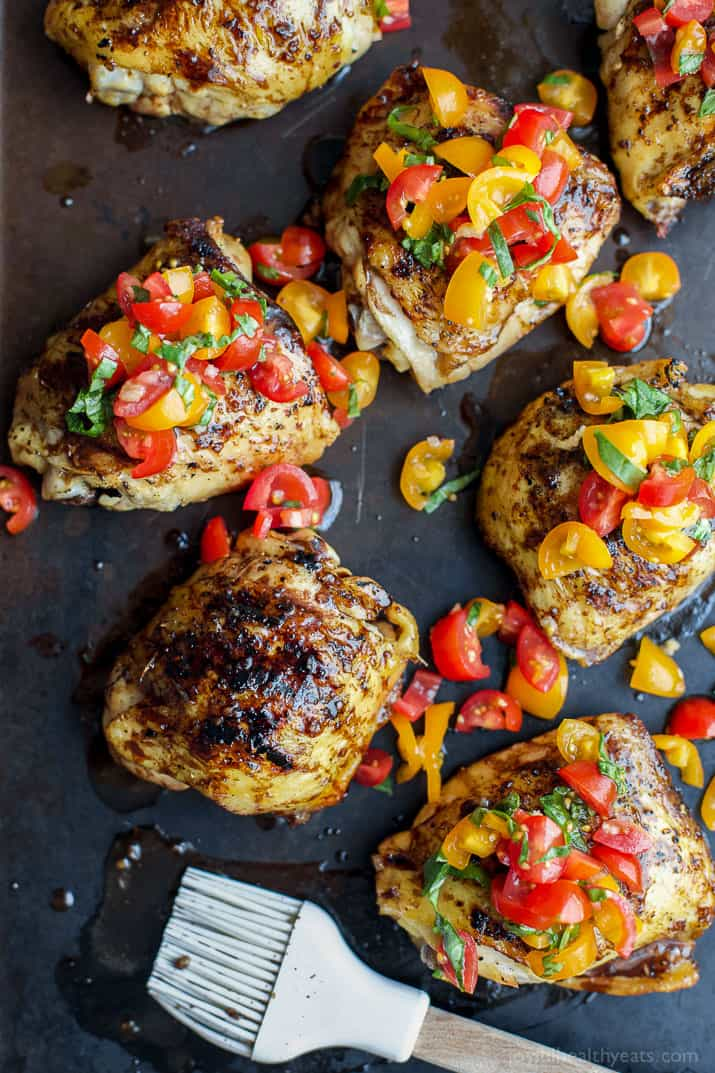 Balsamic Grilled Chicken Thighs topped with a fresh tomato Bruschetta