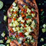 30 Minute Chili Lime Grilled Salmon topped with a fresh Pineapple Salsa! This light healthy recipe is paleo, gluten free and filled with flavor that screams summer!