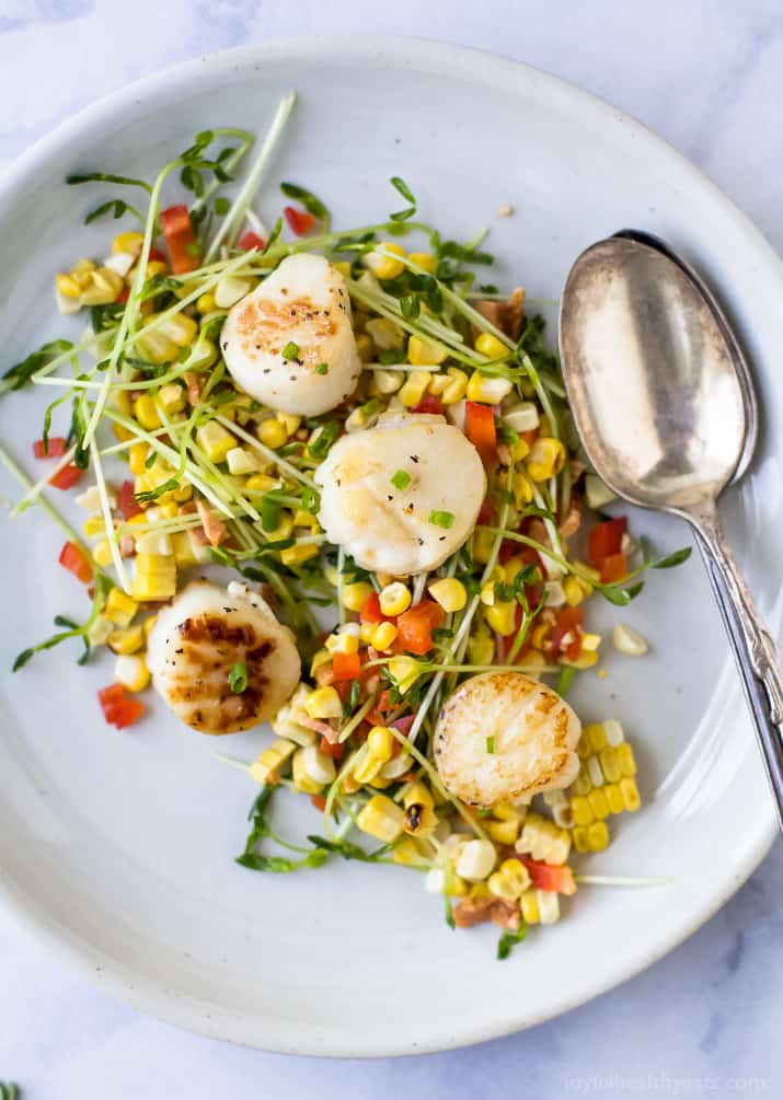 """Seared Scallops with Corn Relish filled with pea sprouts, bacon and red pepper. An easy light recipe that screams summer with an easy """"how to"""" to ensure you get perfectly seared scallops every time. #glutenfree"""