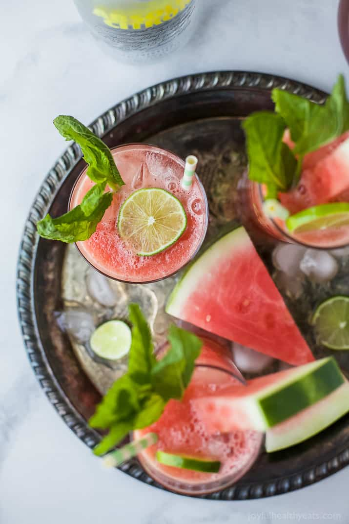 Vodka Watermelon Cocktail the perfect refreshing drink to sip on this summer! Easy, light and made with 4 ingredients you're gonna love this party cocktail! Only 136 calories a serving!