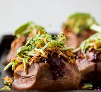 30 Minute BBQ Chicken Stuffed Sweet Potatoes topped with Broccoli Slaw. These Stuffed Sweet Potatoes are an easy gluten free recipe that's perfect for a quick weeknight dinner!