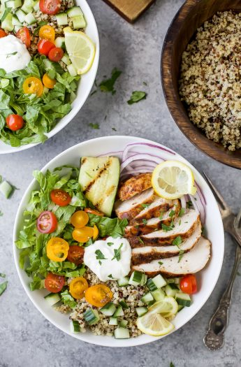 Healthy Chicken Shawarma Bowl served on a bed of quinoa and lettuce then topped with a Garlic Yogurt Sauce. This flavorful gluten free dinner recipe will be devoured in minutes.