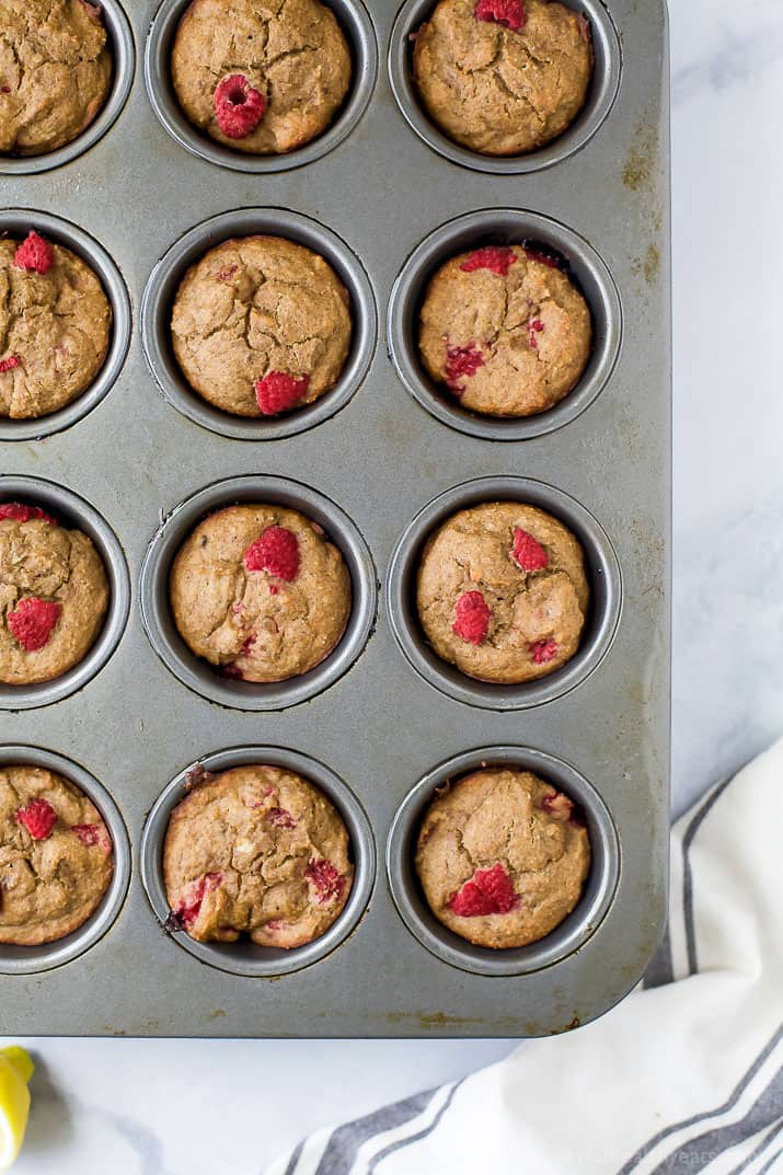 Flourless Lemon Raspberry Protein Muffins with 9 grams of protein per muffin! These berry bursting sugar free muffins are the perfect quick breakfast or post workout snack!
