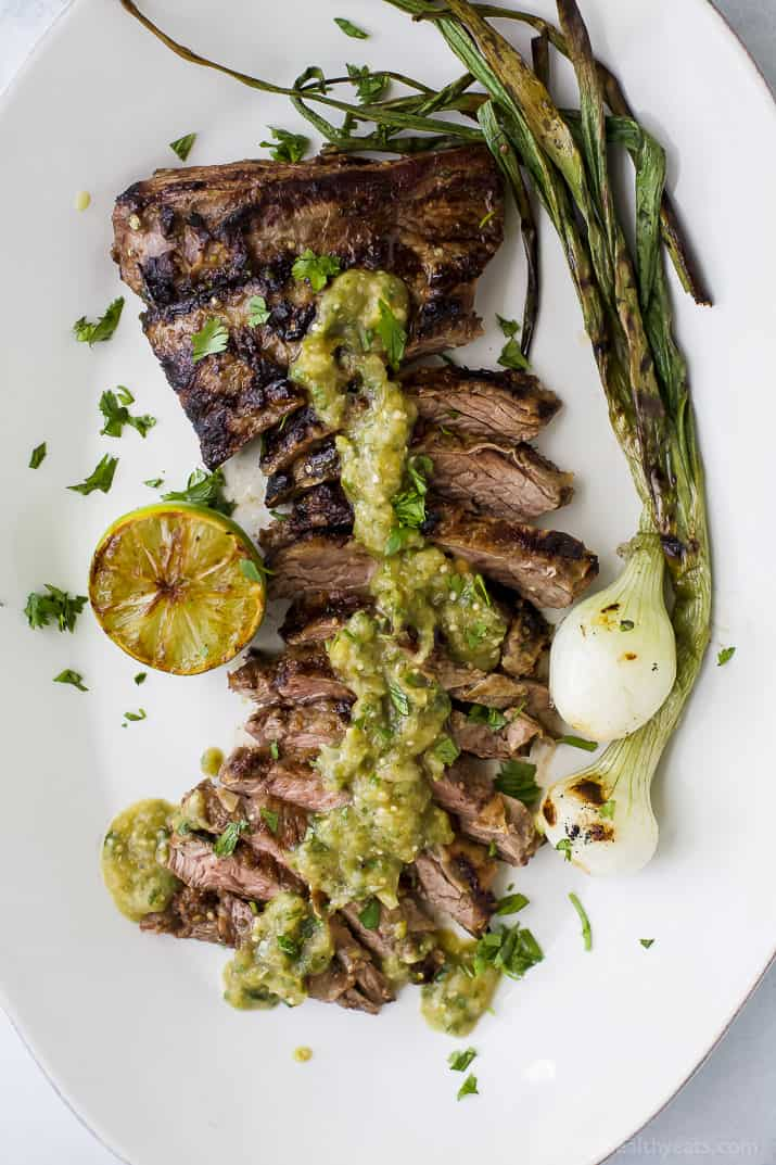 Tender grilled Carne Asada that's marinaded in a homemade Salsa Verde then charred to perfection for one authentic mexican dish! This flavorful low carb Carne Asada will be a hit at your house! Great for a weeknight dinner or dinner parties! #paleo #glutenfree
