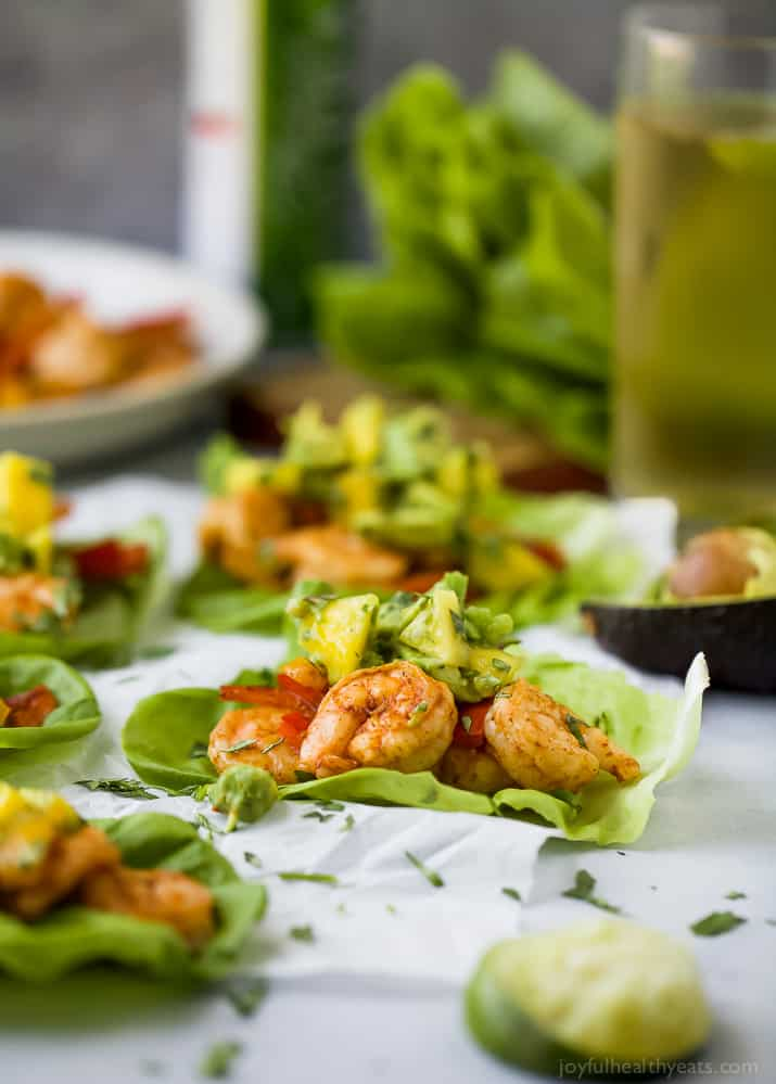 Easy 30 minute Grilled Shrimp Tacos topped with a fresh Mango Avocado Salsa. These flavor bursting gluten free tacos make the perfect light healthy dinner your family will love!