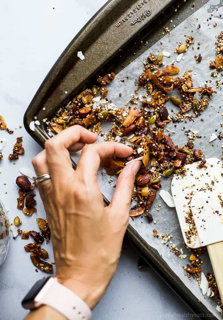 Simple Gluten Free Granola made with nuts, quinoa and toasted coconut. This homemade granola is refined sugar free and loaded with tasty goodness. It's makes the perfect start to your day or mid-day snack!