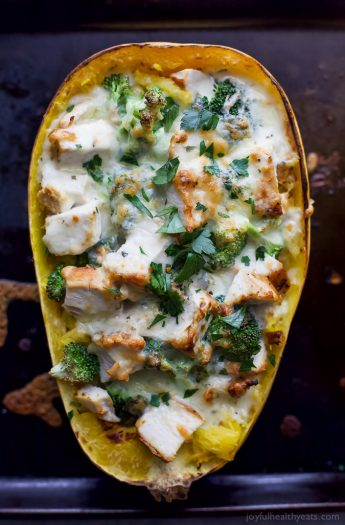 Chicken Alfredo Stuffed Spaghetti Squash, a delicious dinner recipe that screams comfort food but in a healthy way. Spaghetti Squash filled with chicken, broccoli then covered in a cheese sauce! #AD #glutenfree #cabotcheese