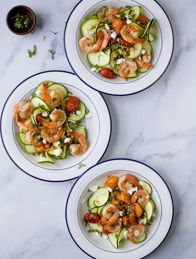 """Creamy Shrimp Pasta tossed with Garlic Blistered Tomatoes and goat cheese- a quick easy weeknight meal that's loaded with delicious flavor. Plus this 30 minute pasta recipe is made """"low carb"""" by using zucchini noodles!"""