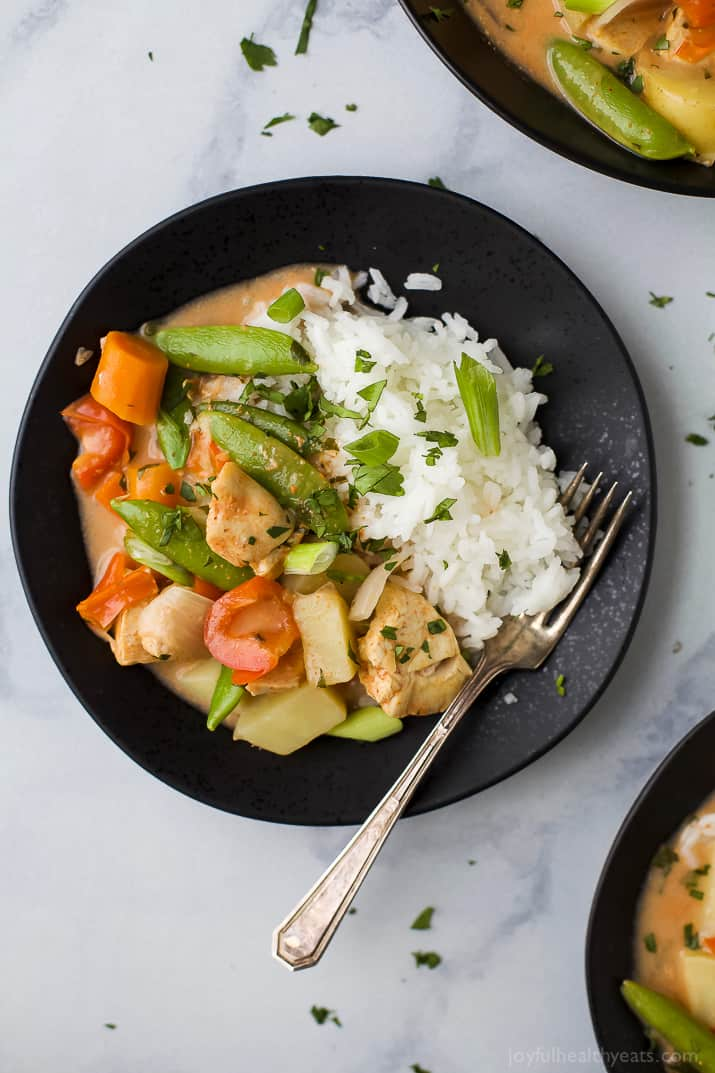 Crock Pot Chicken Curry with coconut milk has never been easier! This simple chicken recipe is the perfect sweet spicy weeknight meal, plus it's loaded with veggies! #glutenfree #dairyfree