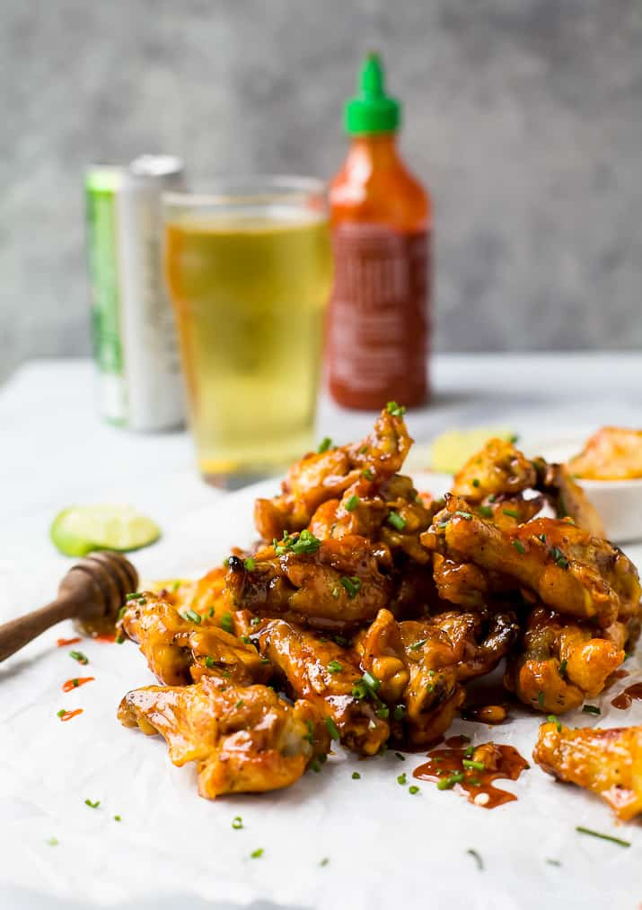 a pile of low carb honey sriracha baked chicken wings