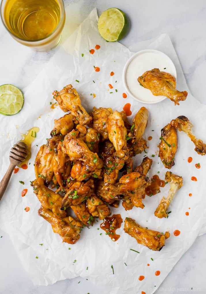 overhead photo of honey sriracha baked chicken wings with ranch
