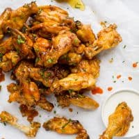 Low Carb Honey Sriracha Baked Chicken Wings, crispy delicious wings baked in the oven then covered with a sweet 'n spicy honey sriracha sauce. These Chicken Wings make the perfect game day appetizer!