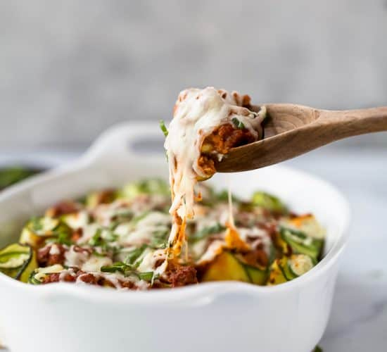 Low Carb Zucchini Lasagna Roll Ups with a homemade Meat Sauce - the perfect healthy comfort food! A ricotta filling wrapped up with zucchini noodles then topped with sauce and more cheese for one delicious bite!