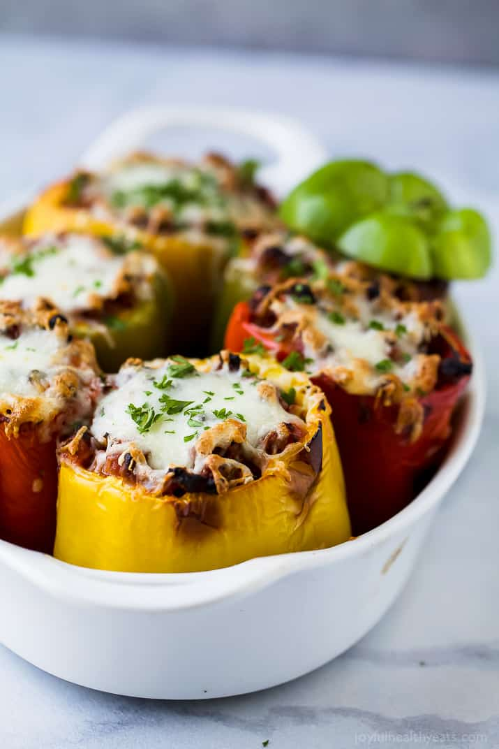 Gluten Free Turkey Bolognese Stuffed Peppers a simple dinner recipe filled with rich flavor your family will love. These Stuffed Peppers make the perfect comforting weeknight meal!
