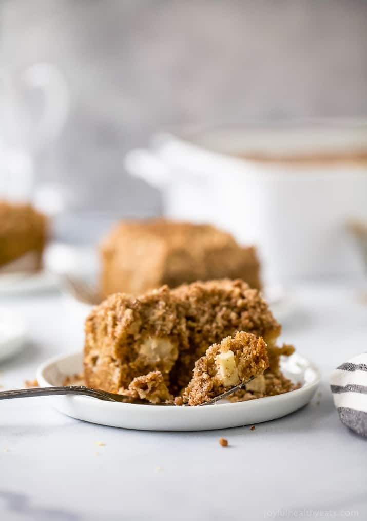 A square of apple cinnamon coffee cake on a plate