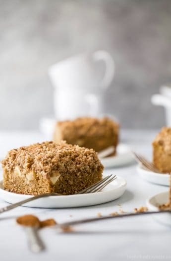 A moist Apple Cinnamon Coffee Cake that screams fall baking! Made with whole wheat flour, filled with bold cinnamon flavor, tender chunks of apple and a crumbly nut topping that you'll want to fight over. Perfect for breakfast or dessert this holiday season!